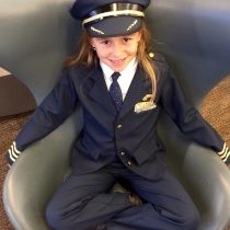Look at what a little cutie we found at the airport! Future Captain, right there!