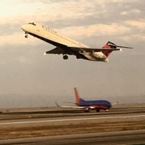 I got this sweet double shot with Delta Connection taking off and Southwest holding short (riding in the back) at SFO.